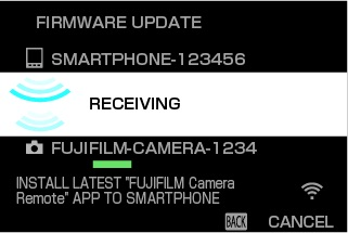 Wait while the smartphone copies the firmware to the camera. (Camera View)